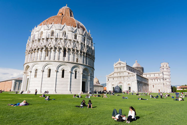 People At Piazza Dei Miracoli Against Sky