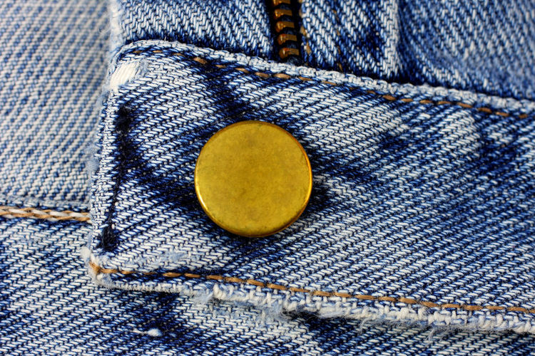 Jeans buttons close up Blue Close-up Clothing; Garment; Fabric; Folded; Texture; Color; Skin; Background; Zipper; Isolated; White; Denim; Jean; Fashion; Close-up; Threadbare; Modern; Up; Cotton; Close; Blue; Pattern; Button Day Fashion Indoors  Jeans No People Textile Textured