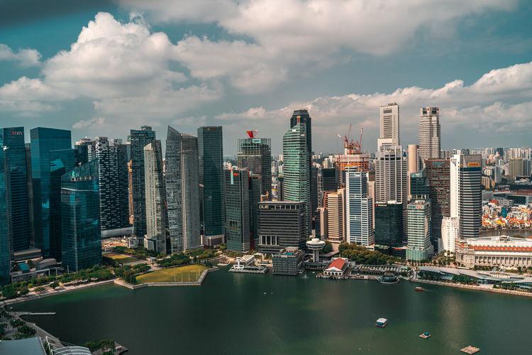 Modern buildings in city against sky in singapore
