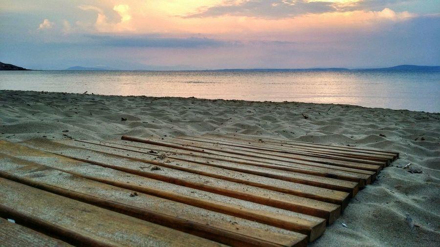Boardwalk On Shore During Sunset