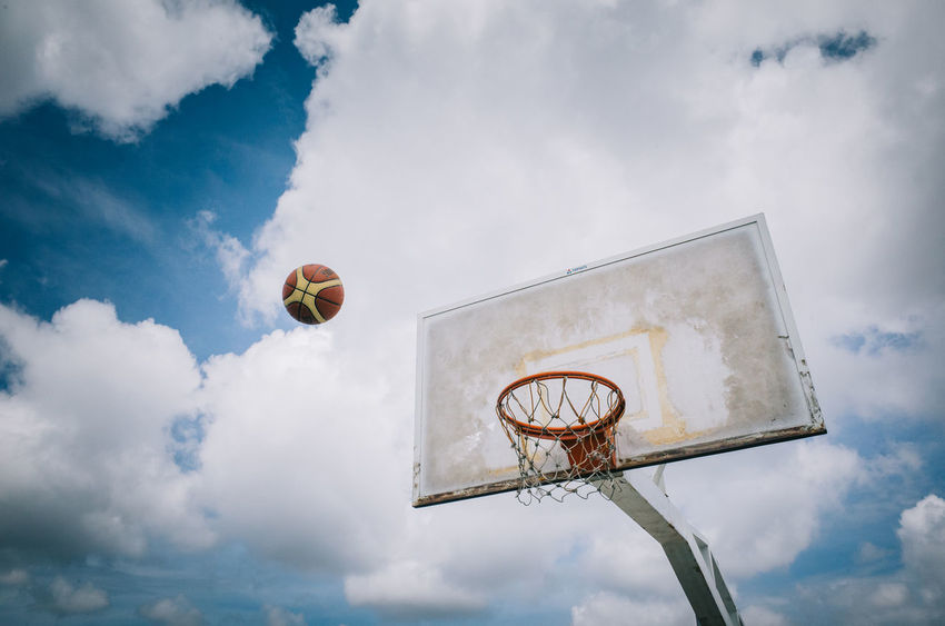 a ball in coming Enjoy The New Normal Embrace Urban Life Ball Basketball Basketball - Sport Basketball Hoop Cloud - Sky Day EyeEm Best Shots EyeEm Gallery Horizontal Low Angle View No People Outdoors Sky Sport The Street Photographer - 2017 EyeEm Awards Colour Your Horizn