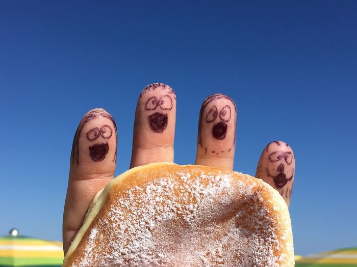 Hand Behind Donut