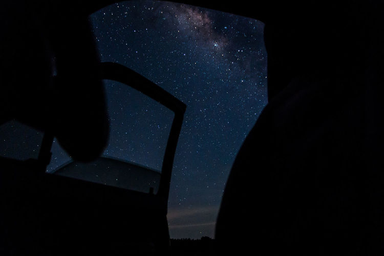 Low Angle View Of Sky Seen Through Window At Night