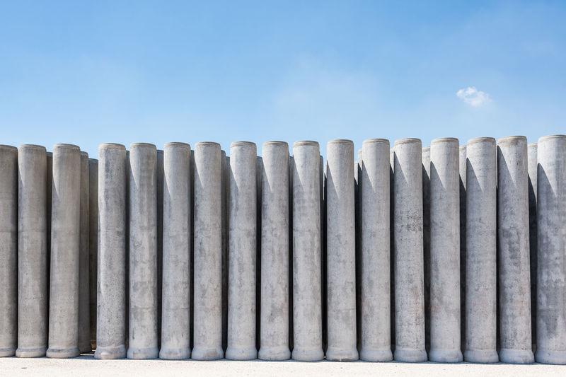 Concrete pipes against blue sky