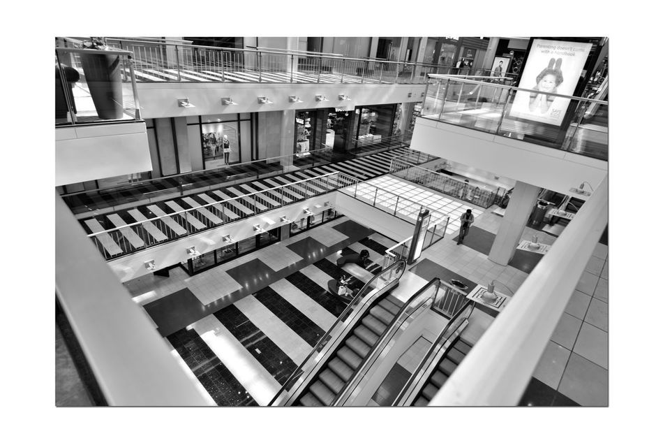 Westfield Centre 2 San Francisco CA🇺🇸 Westfield Centre Upscale Urban Shopping Mall Interior Design Decor Bnw_friday_eyeemchallenge Urban_geometrics Architecture Architectural Detail Floors Escalators Windows Handrails Seating Geometric Shapes Pattern Pieces Monochrome_Photography Monochrome Black & White Black & White Photography Black And White Black And White Collection  Westfield Group