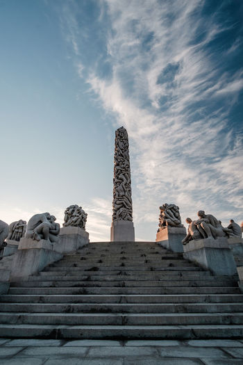 Low angle view of monument against cloudy sky