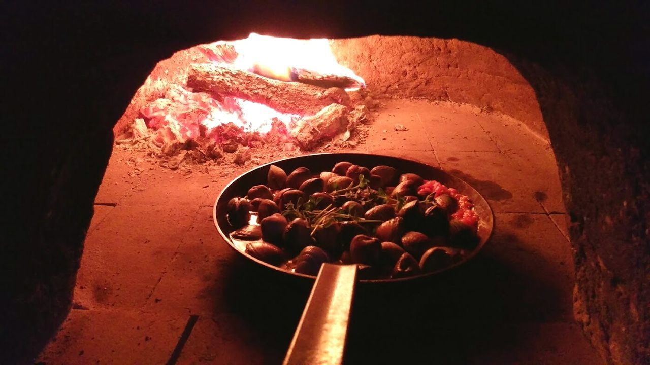 High Angle View Of Pan With Seafood In Wood Burning Stove