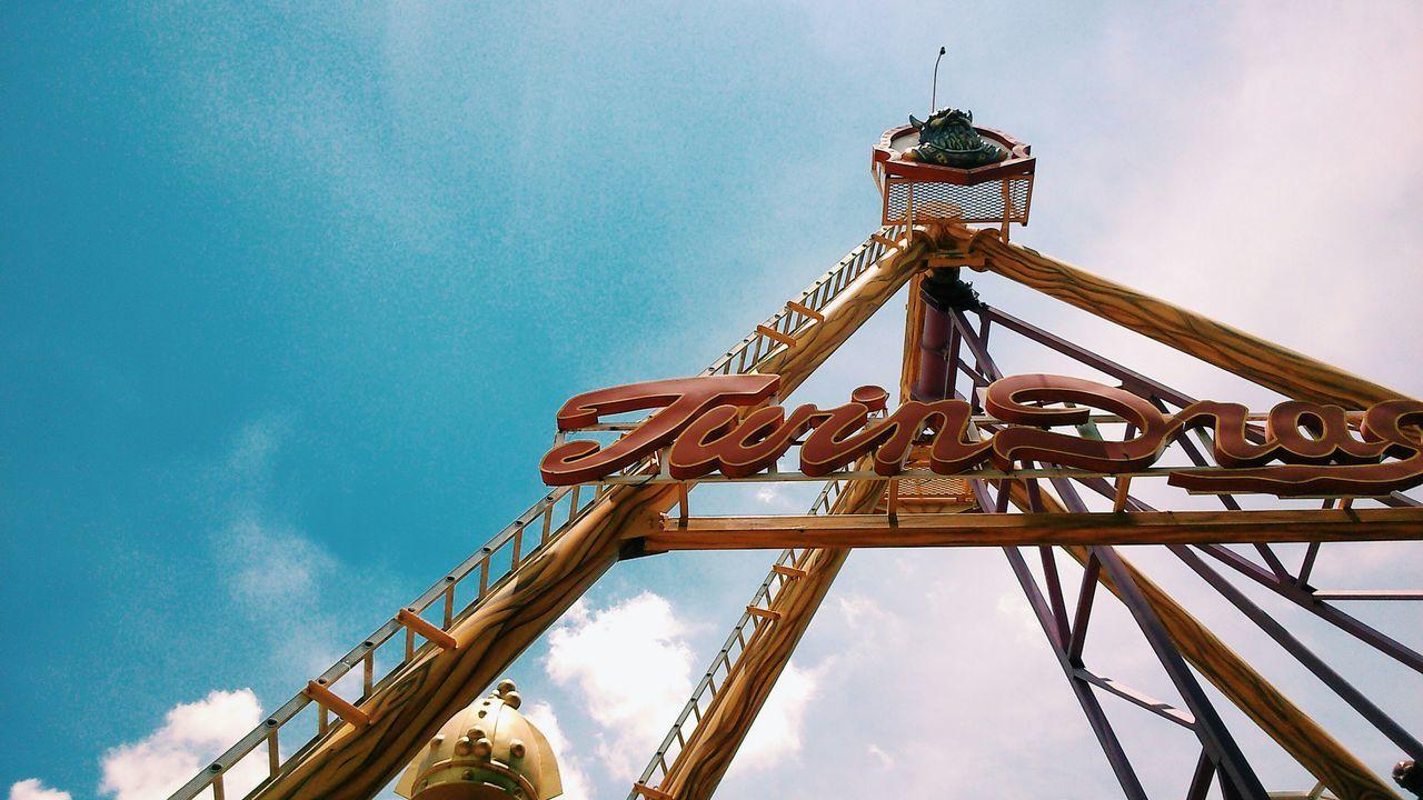 Low angle view of amusement park entrance