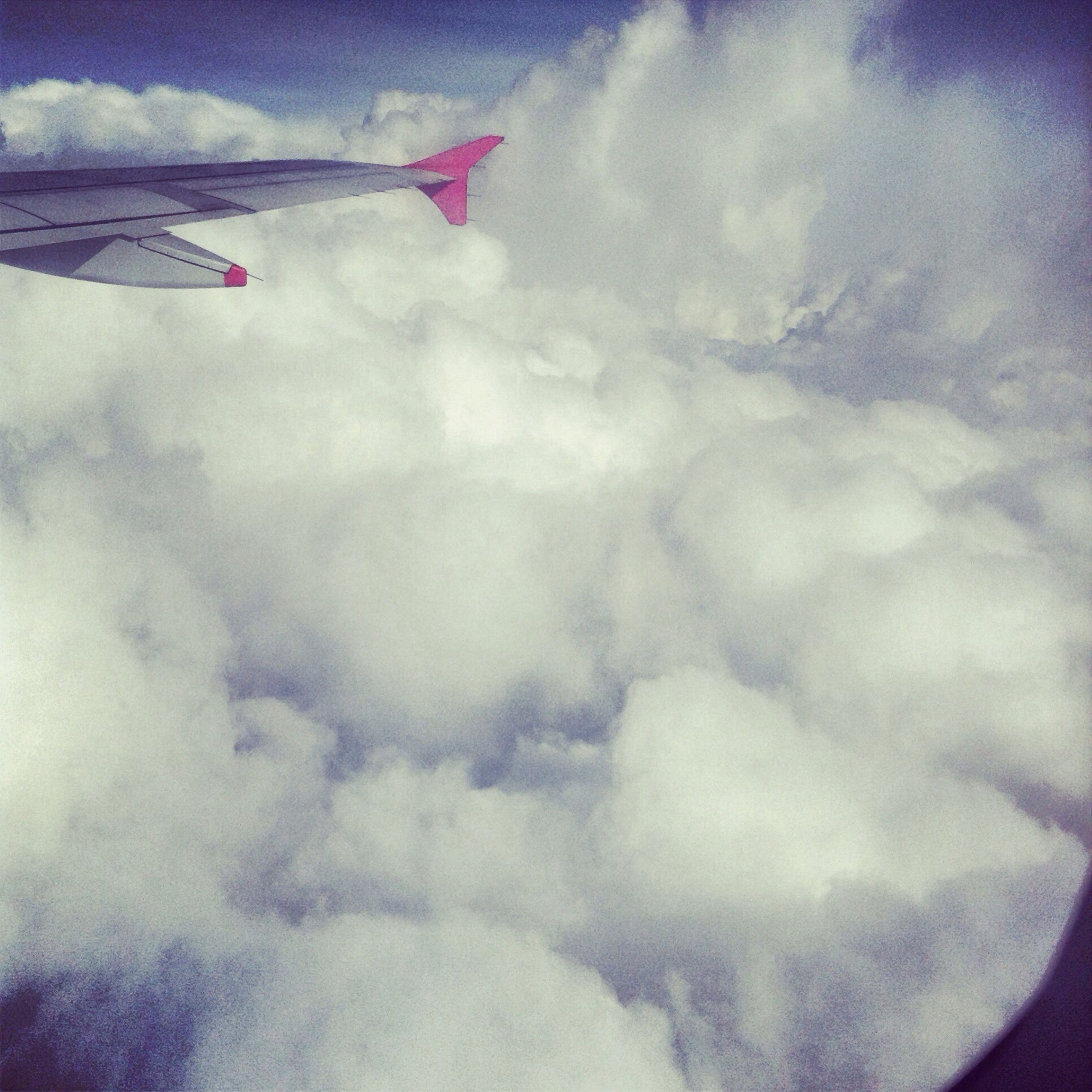 transportation, airplane, air vehicle, flying, mode of transport, sky, aircraft wing, mid-air, cloud - sky, part of, cropped, low angle view, on the move, day, white color, travel, cloud, nature, no people, outdoors