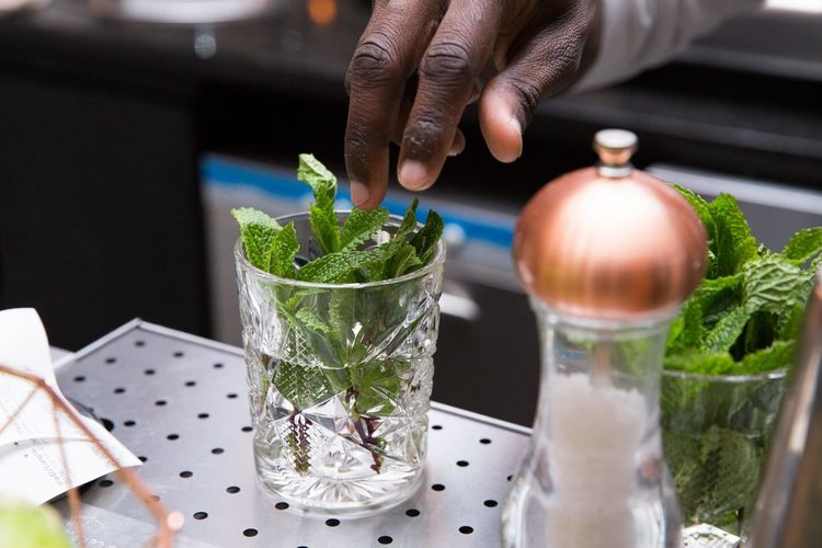 Cropped Hand Of Bartender Preparing Mojito