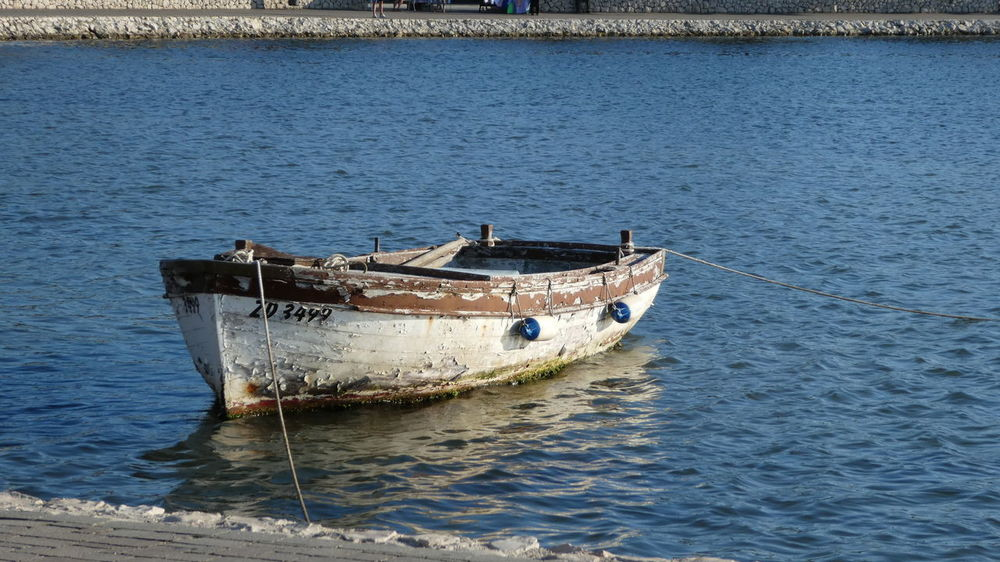 Croatia EyeEm Nature Lover Fishing Village Gone Fishing Holiday Mediterranean  Old Boat Rowboat Travel Day Eyeem Travel Fishing Boat Hrvatska Moored Nature Nautical Vessel No People Old Outdoors Peeling Paint Relax Sea Transportation Travel Destinations Water