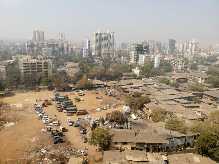 High angle view of slums in city against sky