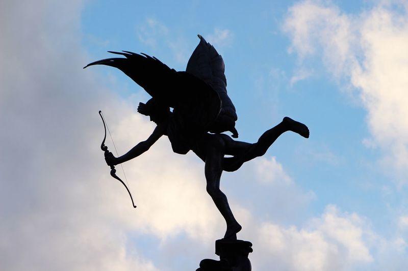 Statue Low Angle View Bird Silhouette Sky Human Representation Art Sculpture Art And Craft Creativity Cloud - Sky Cloud Outline Perching Nature Outdoors Day Avian Cloudydon]