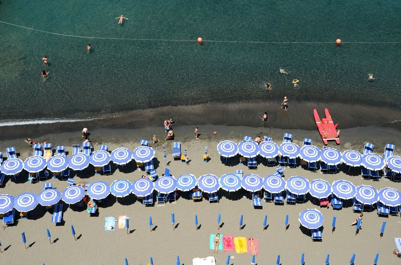 Aerial View Of Parasols And Lounge Chairs At Beach