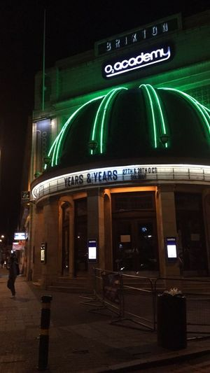 England, UK London Architecture Building Building Exterior Built Structure City Concert England Green Color Illuminated Neon Night Sign Years And Years