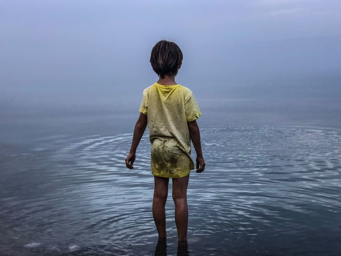 Kid looking at the Dead Sea Kid Dead Sea  Water Sea Rear View Nature Real People One Person Outdoors Childhood Boys Standing Beauty In Nature Ankle Deep In Water Horizon Over Water