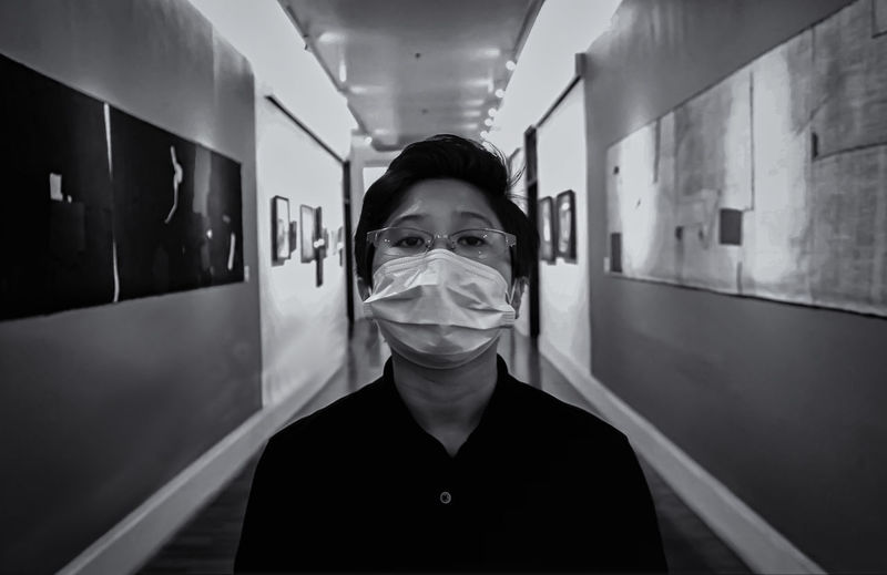 Portrait of man wearing surgical mask