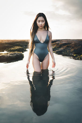Girl in swimsuit walking through a natural pool in Bali, Indonesia Bali INDONESIA Indonesian Nature Portrait Of A Woman Portraits Balinese Connect Dark Mood Girl Indonesian Girl Moody Natural Pool One Person Pool Portrait Portrait Photography Real People Retrato Retratos Sexygirl Swimsuit Water Wet Young Women This Is My Skin #FREIHEITBERLIN The Portraitist - 2018 EyeEm Awards Urban Fashion Jungle Capture Tomorrow