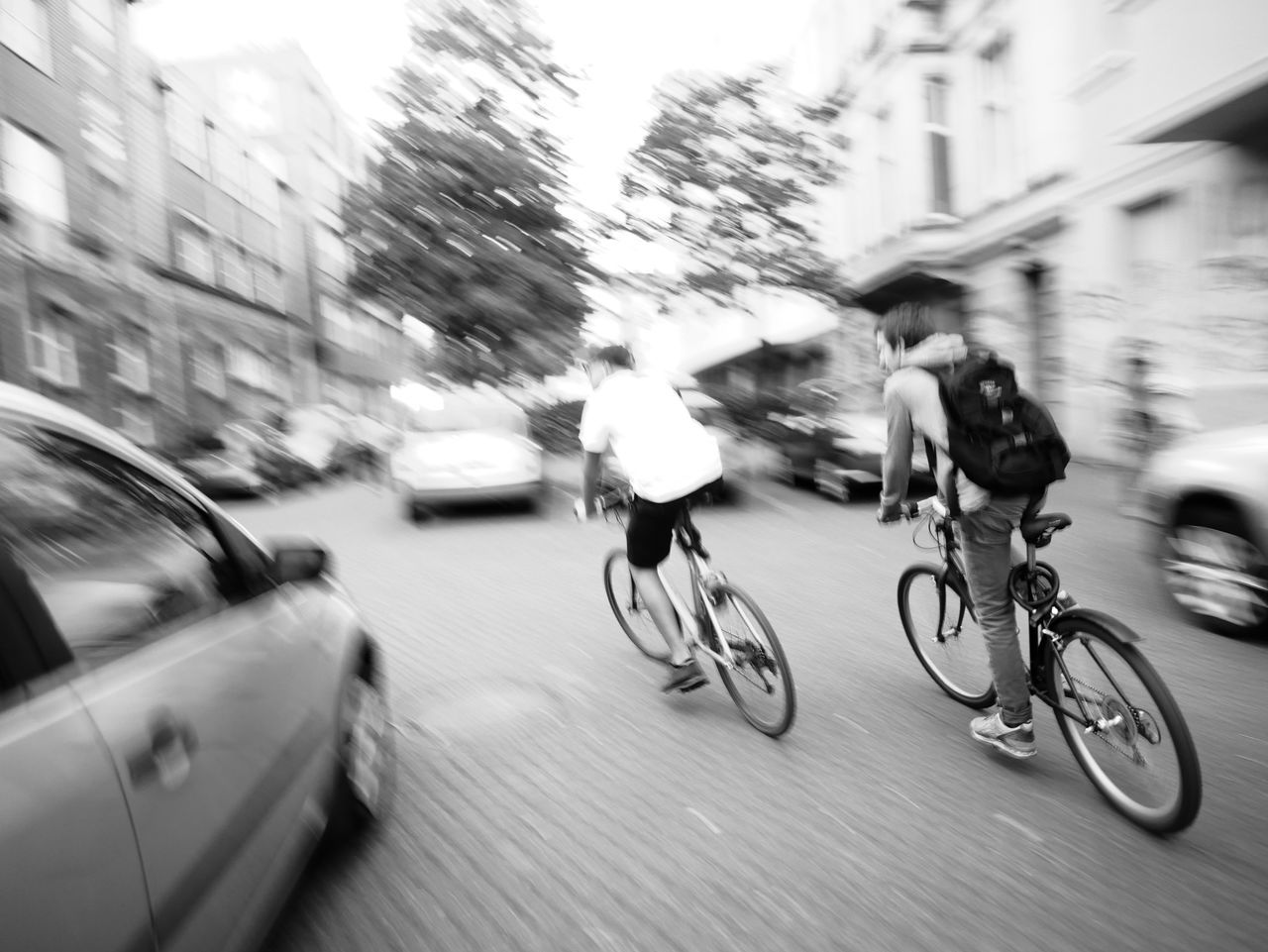 blurred motion, bicycle, motion, speed, mode of transport, transportation, land vehicle, architecture, city, outdoors, built structure, building exterior, day, road, real people, men, people