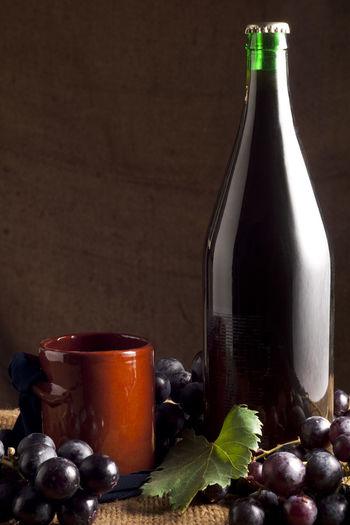 Glass of bottles on table