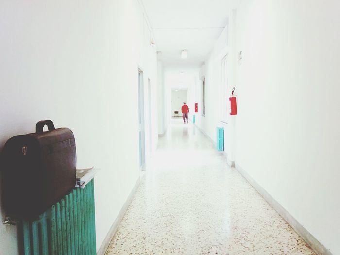 Luggage In Corridor Of Building