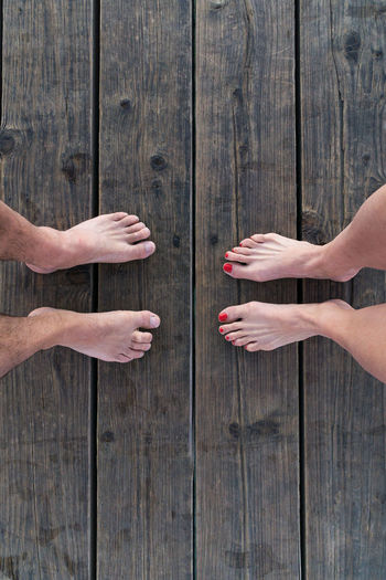 EyeEmNewHere Faced With One Another Love Vacations Close-up Day Face Each Other Friendship Human Body Part Human Foot Man And Woman Outdoors People Red Toes Toes Togetherness Towards Two Humans Two People Wood - Material