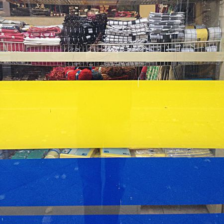 Blue and yellow stripes on household supply store's glass window Stripes Window At The Supermarket Urban Geometry
