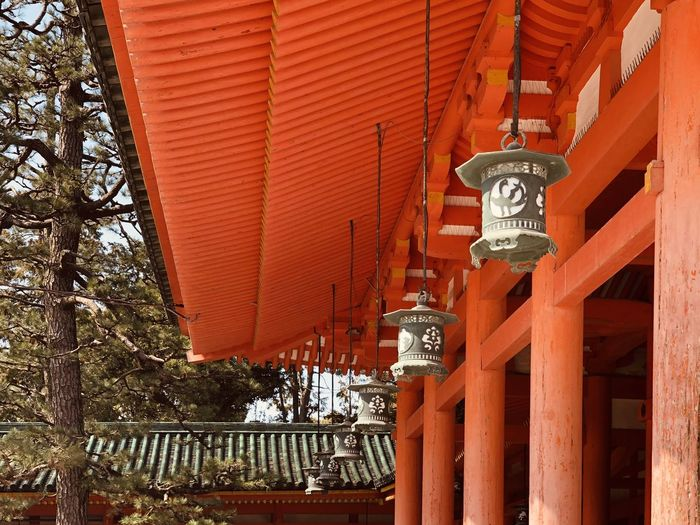 Low angle view of illuminated lanterns by building