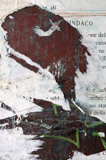Close-up of text on old wall