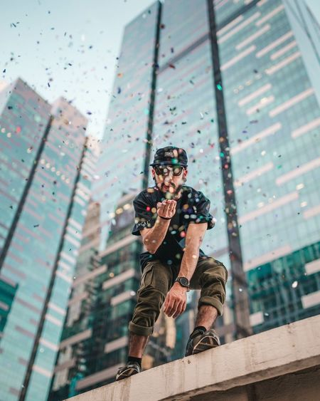 kissing 2016 goodbye Blowing Kisses Confetti Street Fashion Hypebeast  Portrait Portrait Of A Man  Portrait Photography One Man Only Singapore City City Life Architecture Roof Top Fine Art Photography Bokeh Photography Adapted To The City The Portraitist - 2017 EyeEm Awards