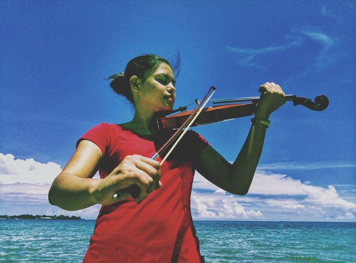 Women Beauty Portrait Violinist Cloud - Sky Low Angle View One Woman Only Red Blue Outdoors Capture The Moment The Great Outdoors - 2018 EyeEm Awards