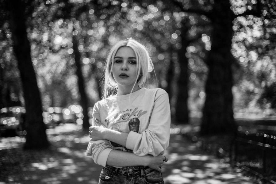 The Portraitist - 2017 EyeEm Awards cherry One Person Focus On Foreground Front View Real People Tree Portrait Standing Leisure Activity Arms Crossed Lifestyles Looking At Camera Young Adult Childhood Outdoors Day Beautiful Woman Nature Beauty Young Women Blond Hair Black And White Friday