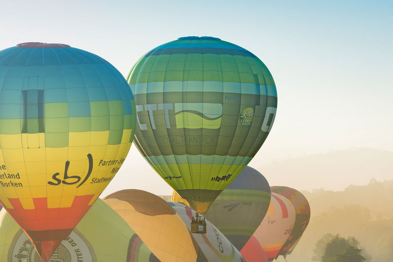 Start of the hot air balloons in oeventrop in the morning mist. warstein international montgolfiade