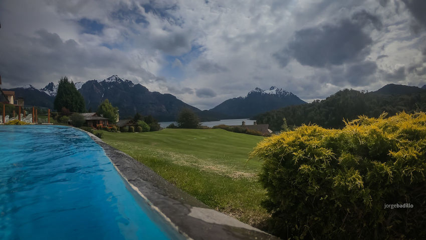 Hotel #LlaoLlao #Argentina #Bariloche Cloud - Sky Sky Plant Mountain Water Tree Nature Beauty In Nature Scenics - Nature Tranquility Day No People Tranquil Scene Grass Swimming Pool Architecture Mountain Range Outdoors Built Structure Bariloche, Argentina Llao Llao Patagonia Argentina
