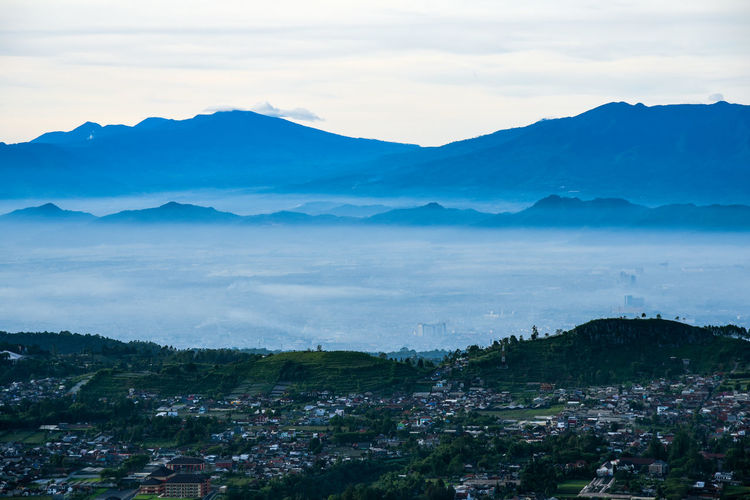 Bandung City from Putri Mountain Mountain Sky Scenics - Nature Cloud - Sky Beauty In Nature Environment Landscape Tranquil Scene Tranquility Nature Mountain Range No People Day High Angle View Outdoors Architecture Non-urban Scene Plant Tree Nikonphotography Cityscape Bandung Urbanphotography City