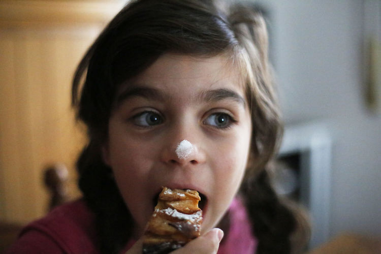Close-up of girl eating dessert at home