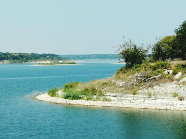 Lake Belton's vast beauty. Relection On Water Trees Peninsula Texas Landscape Beauty In Nature Blue Water Green Color Lake Rocky Shore Tree Water Clear Sky Blue Sky Horizon Over Water Landscape Island