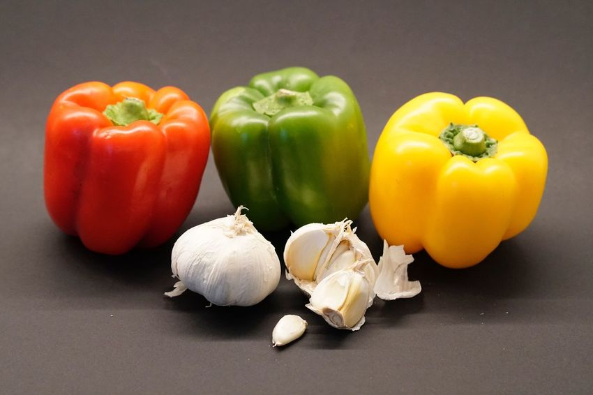 Still Life Vegetable Food Food And Drink Healthy Eating Red Bell Pepper Bell Pepper Freshness Studio Shot Garlic Table No People Close-up Indoors  Black Background Day Gemüse