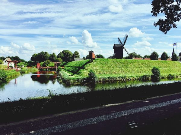 Festung Castle Bourtange Netherlands Groningen Burg Cloud - Sky Sky Nature Day Outdoors Built Structure Architecture Tree Sun Shadow Shadows & Lights Medieval Green Blue Wall Water Vesting Clouds EyeEmNewHere Your Ticket To Europe