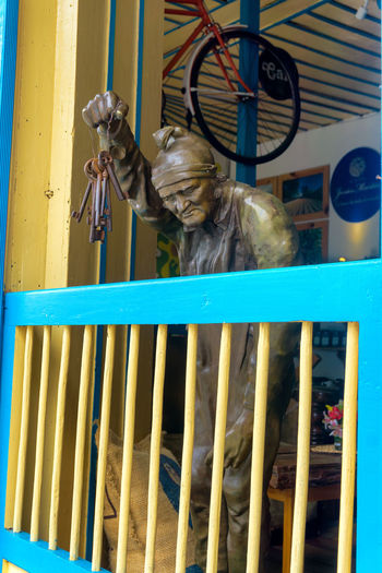 SALENTO, COLOMBIA - JUNE 6: Statue holding keys in a coffee shop in Salento, Colombia on June 6, 2016 America Architecture Building Center Colombia Colonial Color Culture Destination Historic House Landmark Outdoors Quindío Salento Sculpture South Street Tourism Tourist Town Travel View Village Wall