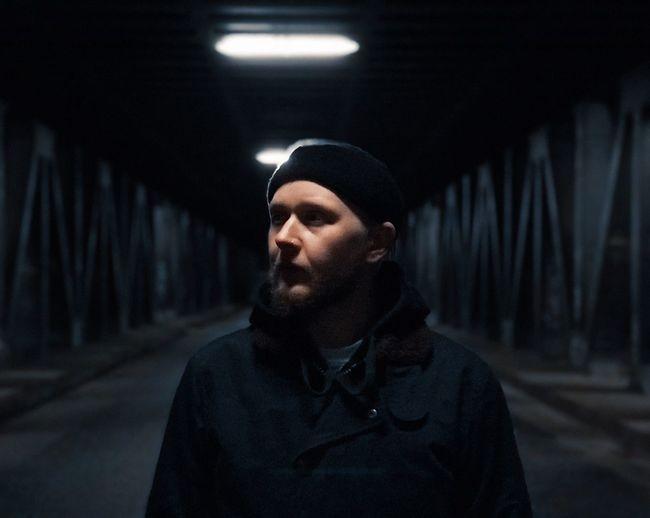 Man in illuminated room