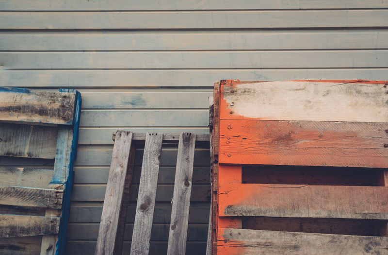 Close-up of wooden crates against wall