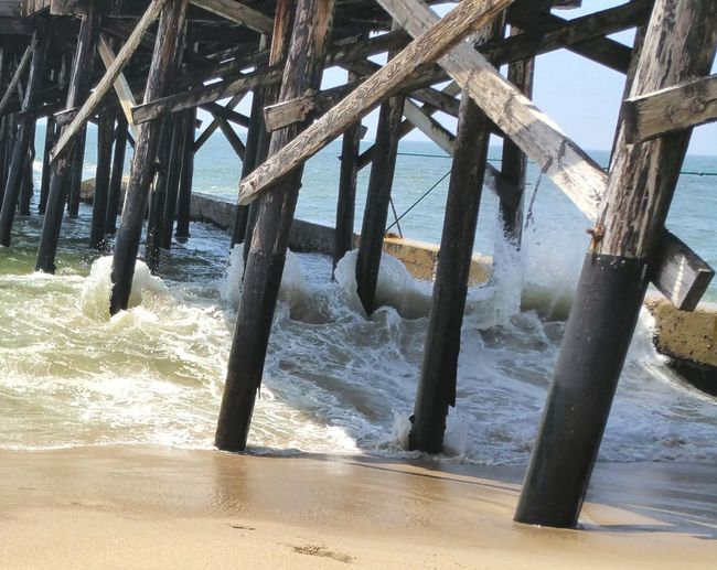Waves Wrapping Aroung Pier Pilings Waves, Ocean, Nature Waves Crashing Walking The Beach Pattern, Texture, Shape And Form Oceanside Enjoying The Sun Check This Out This Week On Eyeem The Wave Summer Fun