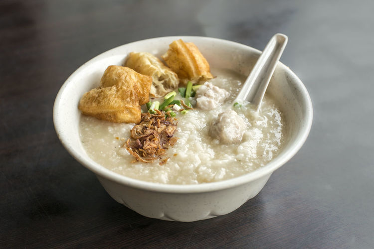 Meat Ball Porridge Ready-to-eat Table Bowl Food Food And Drink Indoors  Spoon Eating Utensil Still Life Serving Size Focus On Foreground Healthy Eating Close-up No People Meat Wellbeing Asian Food Garnish Porridge Singapore Food Hawker Food