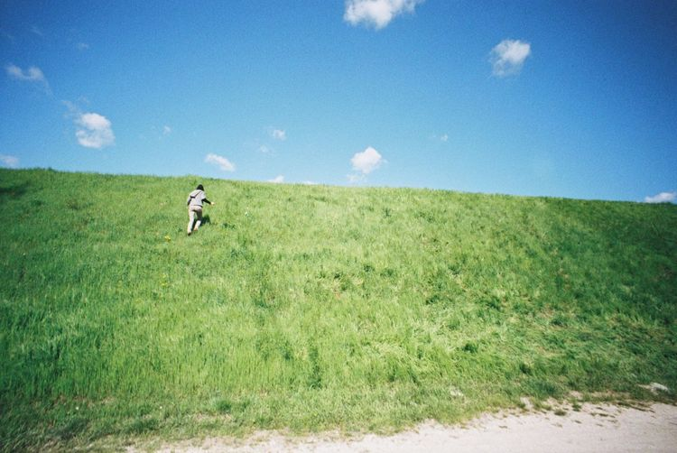 Woman running up on the hillside