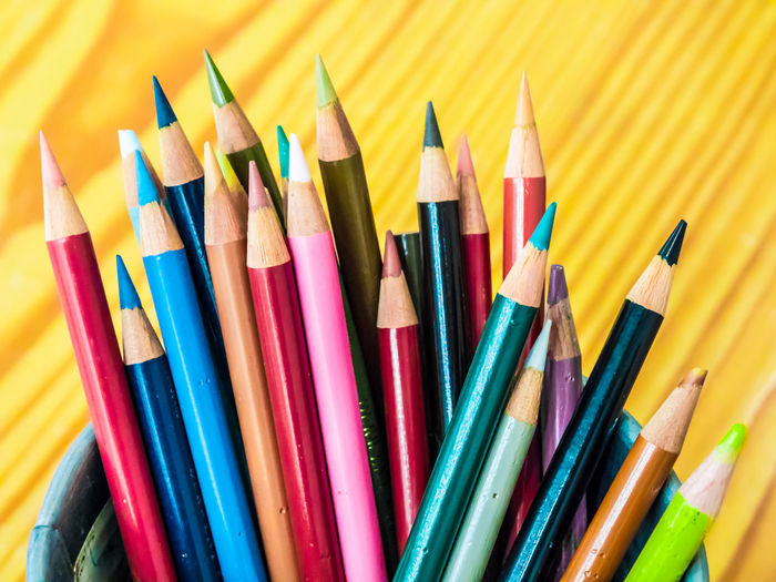 Multicolored pencils are combined in a steel box on a desk in the office. Art Background Blue Bright Brown Closeup College Color Colored Colorful Colors Colour Concept Crayon Crayons Creative Design Draw Drawing Education Equipment Frame Green Group Image Isolated Macro Object Office Orange Paint Palette Pen Pencil Pencils Rainbow Red Row School Set Sharp Stationery Supplies Up Variation Vector White Wood Wooden Yellow Multi Colored Large Group Of Objects Writing Instrument Choice Art And Craft Colored Pencil Close-up Still Life No People Craft Creativity Indoors  High Angle View Studio Shot Art And Craft Equipment Wood - Material Vibrant Color Variety