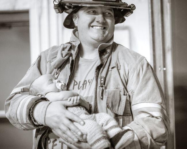 Family Fatherhood Moments Firefighter Love NewBorn Photography Affectionate Blackandwhite Helment Holding Newborn Baby Portrait Prouddad Uniform Cap