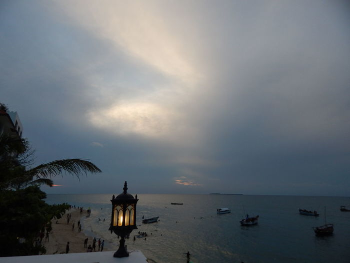 Stone Town, Zanzibar Sunset Architecture Beach Beauty In Nature Cloud - Sky Day Dusk Horizon Over Water Nature No People Outdoors Palm Tree Scenics Sea Sky Sunset Tranquility Water