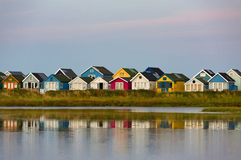 Beach huts Residential Beach Cottages Reflections In The Water EyeEm Selects Wood EyeEm Gallery Seaside Holidays Seascape Multi Colored Beach Sea House Water Reflection Sky Architecture Beach Hut Hut Tide Coast Holiday Villa