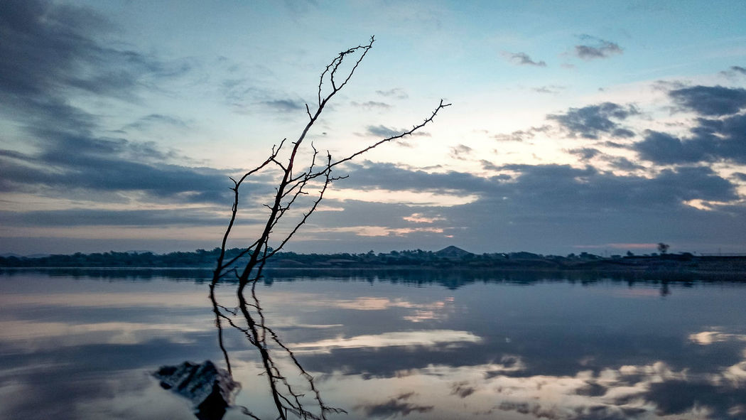 Follow with the current. Reflection Water Sky Lake Tranquility Cloud - Sky Nature Outdoors Beauty In Nature Sunset Tranquil Scene Scenics No People Horizon Over Water Day Tree Real People Incredibleindia Perspectives On Nature Fishing Canonindia Reflection Beauty In Nature Landscape